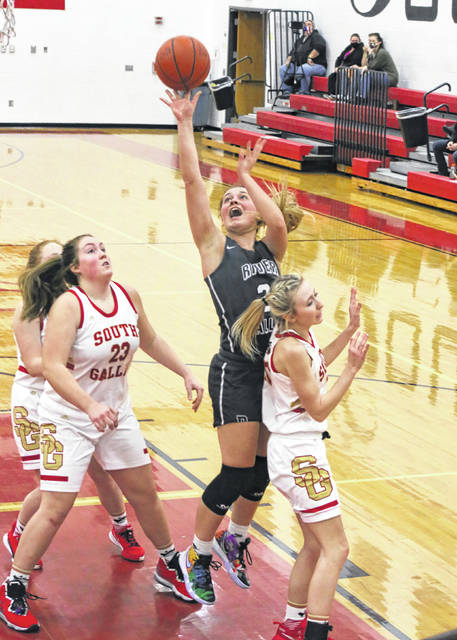 River Valley senior Hannah Jacks releases a shot attempt over a pair of South Gallia defenders during a Jan. 18 girls basketball contest in Mercerville, Ohio.