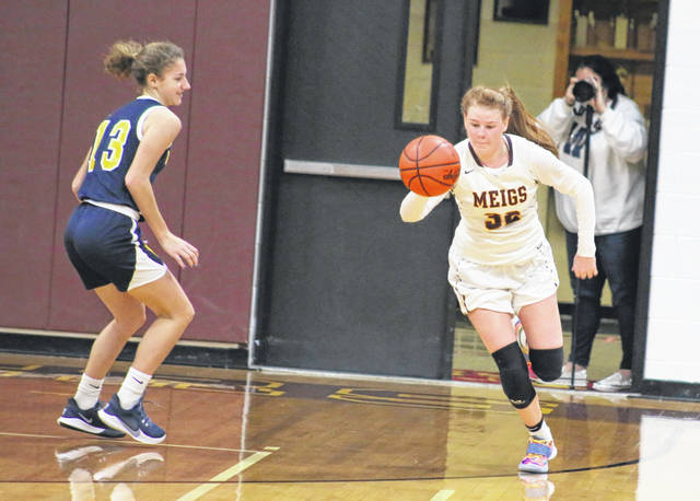Meigs junior Mallory Hawley, right, starts a fast break during the first half of a Jan. 14 girls basketball contest against Wellston at Larry R. Morrison Gymnasium in Rocksprings, Ohio.