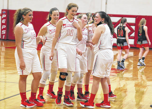 Members of the Wahama girls basketball team share a smile as Ravenswood walks back to the locker room on Monday night following the conclusion of 72-71 triple overtime victory at Gary Clark Court in Mason, W.Va.