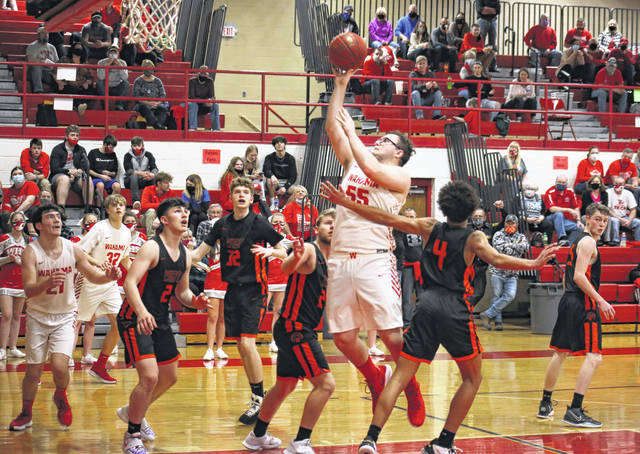 Wahama sophomore Michael VanMatre (55) hits a two-pointer from the lane, during the second half of the White Falcons' 61-33 victory on Thursday in Mason, W.Va.