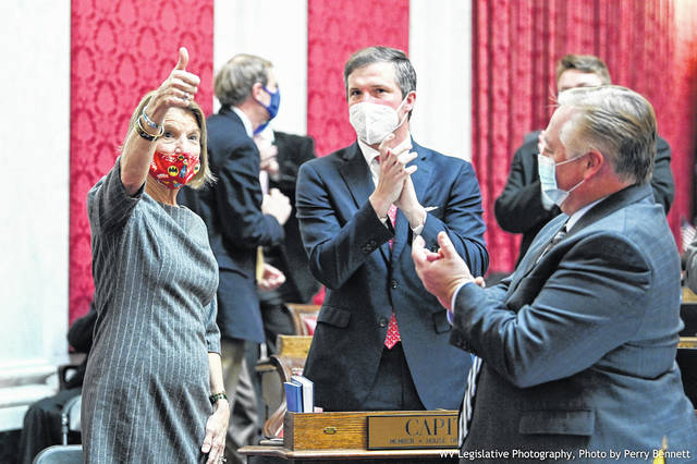 U.S. Senator Shelley Moore Capito (R-W.Va.) visits the floor of the West Virginia House of Delgates last week. Also pictured, Delegate Moore Capito, the senator's son. (West Virginia Legislative Photography, photo by Perry Bennett)