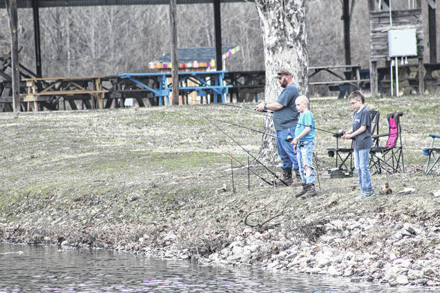 """Fishermen from both Ohio and West Virginia have been gathering along the banks of Krodel Park following the recent stocking of trout. In addition, kicking off next week is the """"Gold Rush"""" trout stocking program where golden rainbow trout will be stocked at locations across the Mountain State. Though none of those """"Gold Rush"""" locations are in Mason County, these three fisherman at Krodel Park this week didn't seem to mind. More on the """"Gold Rush"""" in the weekend edition. (Beth Sergent 