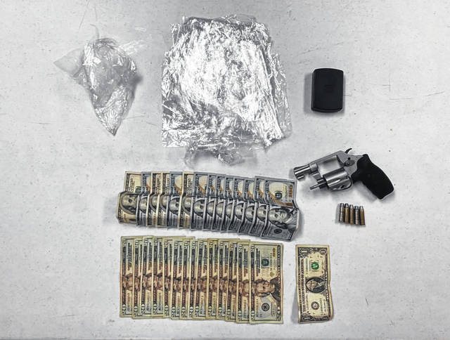 A suspected stolen weapon and alleged drugs were located during a traffic stop in Mason.