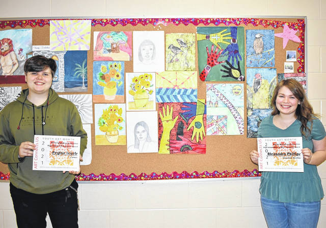 """Wahama High School art students Peyton """"Kai"""" Ingels, left, and Alexandra Phillips received honors recently at the Youth Art Month Show in Parkersburg. Their pieces will now go to """"Arts Alive"""" in Charleston. (Mindy Kearns 