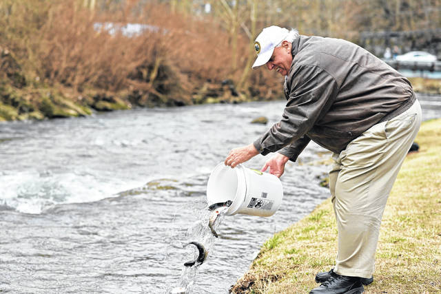 Gov. Jim Justice kicked off the spring trout stocking season last week, ceremonially stocking the first of over 1,400 trout that were released at Buffalo Creek. (Office of Gov. Jim Justice | Courtesy)