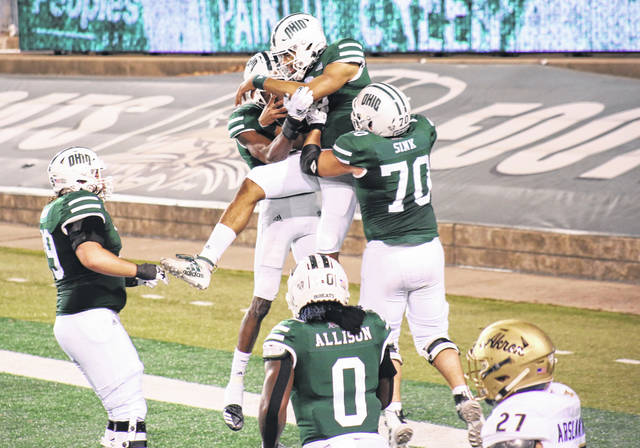 Members of the Bobcat offense celebrate an Armani Rodgers touchdown run, during Ohio's Nov. 10, 2020, victory over Akron in Athens, Ohio.