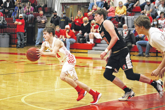 Wahama freshman Bryce Zuspan (3) grabs a rebound and starts a fast break in front of PPHS sophomore Eric Chapman, during Point Pleasant's 63-38 victory on Saturday in Mason, W.Va.