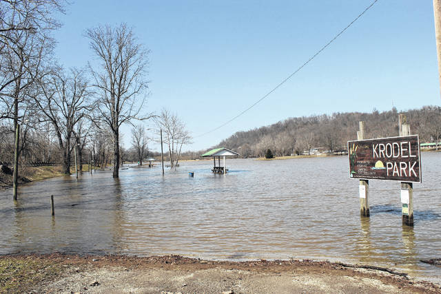 The lake at Krodel Park spills over its banks on Thursday with one end of the park open to traffic, while the other was still flooded under water. (Beth Sergent | OVP)