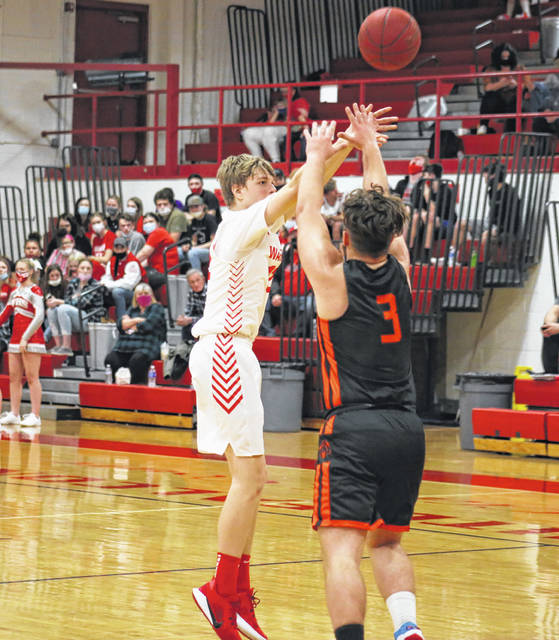 Wahama sophomore Ethan Gray launches a three-pointer over a Wirt County defender, during a March 11 game in Mason, W.Va.