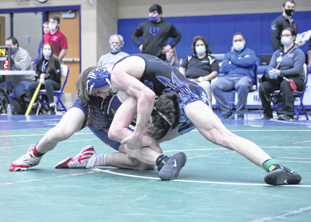 Gallia Academy junior Todd Elliott maintains leverage on an opponent during a 126-pound match at the Division II District wrestling championships held Saturday at Gallia Academy High School in Centenary, Ohio.