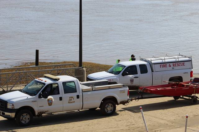 Firefighters from the Point Pleasant Volunteer Fire Department gathered at the Gallipolis Public Use Area earlier this month while searching for a missing woman in the Ohio River. At one point, over 85 first responders from across West Virginia and Ohio joined in the search. (Beth Sergent   OVP)