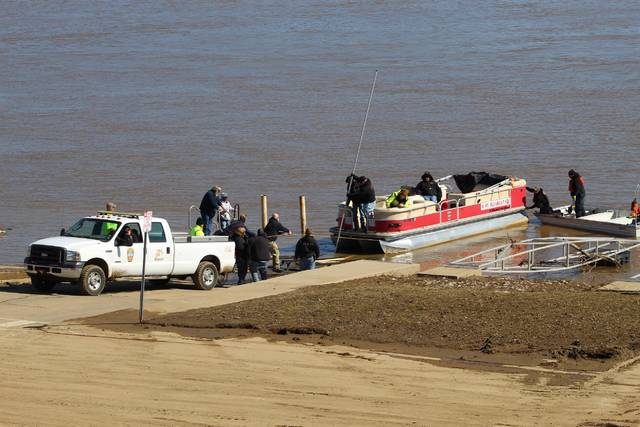Volunteer firefighters deal with high water and a swift current on Saturday afternoon when attempting to load a search and rescue boat belonging to the Point Pleasant Fire Department. First responders in the recovery effort set up in the Gallipolis Public Use Area near City Park. (Beth Sergent | OVP)