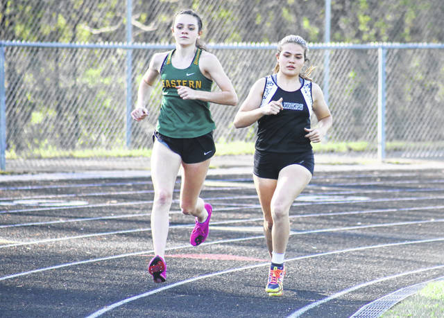 Eastern's Erica Durst (left) and River Valley's Lauren Twyman (right) race for the lead in the first lap of the 1600m run during Tuesday's quad meet in Bidwell, Ohio.