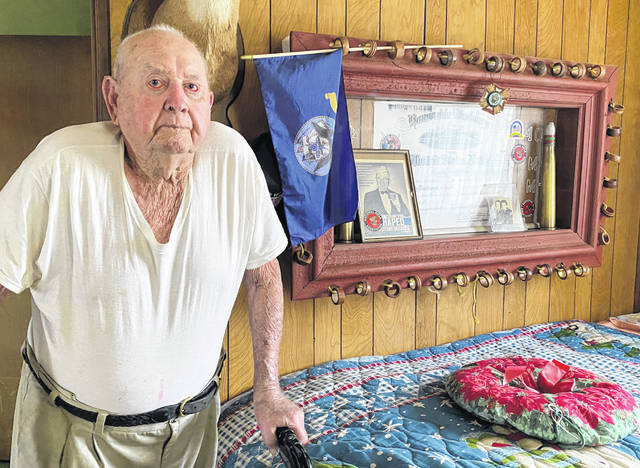 """Bill McFarland of New Haven will be turning 100 years old on May 4. The Town of New Haven has declared the occasion """"Bill McFarland Day"""" and will hold a drive-by card shower for him from 4 to 6 p.m. McFarland, a former U.S. Navy Gunner Mate, is shown at his home next to a Navy display box he designed."""