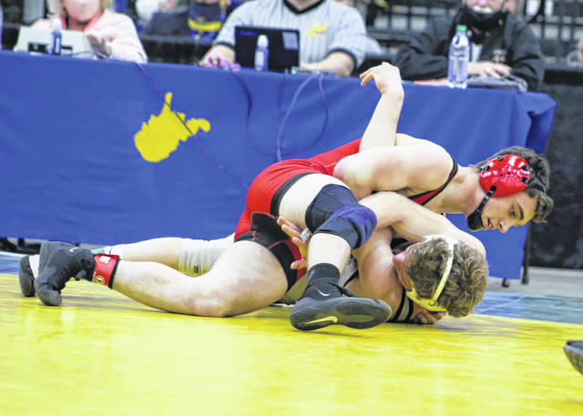 Point Pleasant junior Derek Raike locks in a hold on an opponent in the 145-pound Class AA-A championship match Thursday night in Huntington, W.Va.