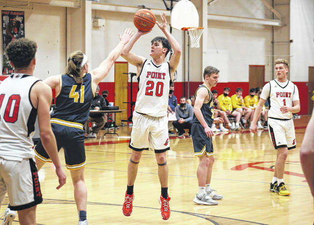 PPHS junior Luke Derenberger (20) shoots over Buffalo's David Whittington (41), during the second half of Thursday's game in Point Pleasant, W.Va.