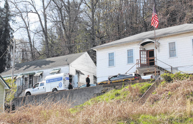 Law enforcement officials were on the scene of a homicide on Legion Terrace throughout the day on Sunday.