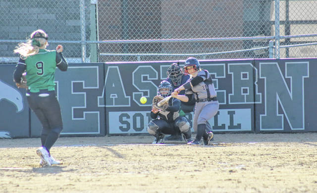 River Valley's Grace Hash (24) doubles off a pitch thrown by Eastern's Tessa Rockhold (9), while EHS catcher Kelsey Roberts looks on, during Friday's non-league game in Tuppers Plains, Ohio.