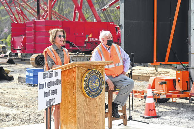 U.S. Senator Shelley Moore Capito (R-W.Va.) speaks at a groundbreaking ceremony on Wednesday for the I-64 Nitro/St. Albans Bridge alongside Gov. Jim Justice (R). The $224.4 million project is part of the governor's Roads To Prosperity program. (Office of Gov. Jim Justice | Courtesy)