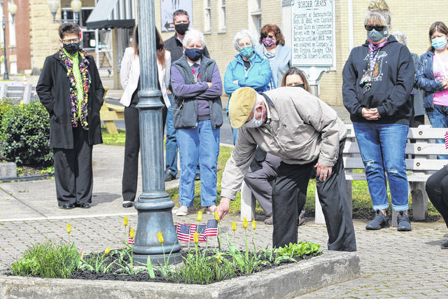 American flags were placed in memory of loved ones who died from COVID-19 during a remembrance ceremony honoring victims of the virus held in Gunn Park this week.