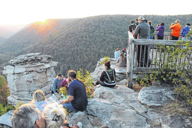 A crowd gathers at Lindy Point for sunset at Blackwater Falls State Park, one of West Virginia's popular tourist destinations. (Beth Sergent | OVP)