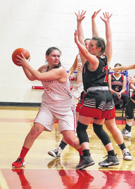 Wahama senior Torre VanMatre, left, looks to make a pass during the first half of a girls basketball game against Ravenswood on March 8 at Gary Clark Court in Mason, W.Va.