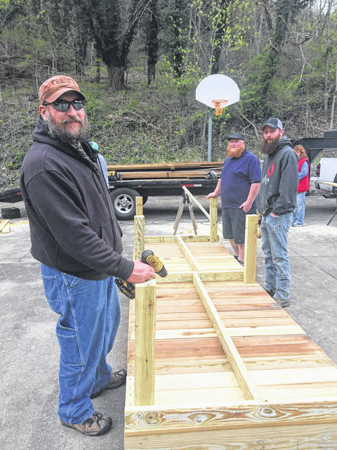April 2021 Community Gardens at Mulberry: Jason Underhill (left), Chris Burkhamer (front right), and Joe Rosler (back right) worked with Meigs County Farm Market volunteers to construct nine raised beds for the Community Garden at the Mulberry Community Center in Pomeroy.