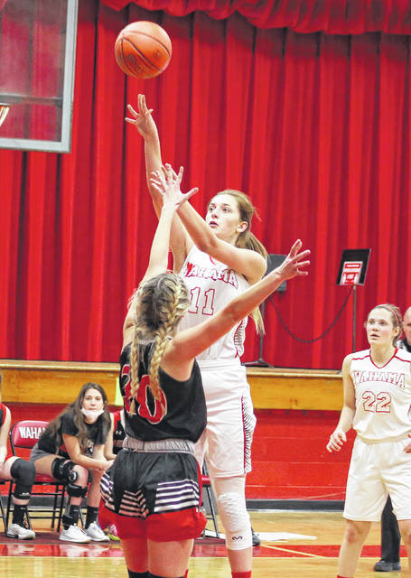 Wahama senior Emma Gibbs releases a shot attempt during a March 6 girls basketball game against Ravenswood at Gary Clark Court in Mason, W.Va.
