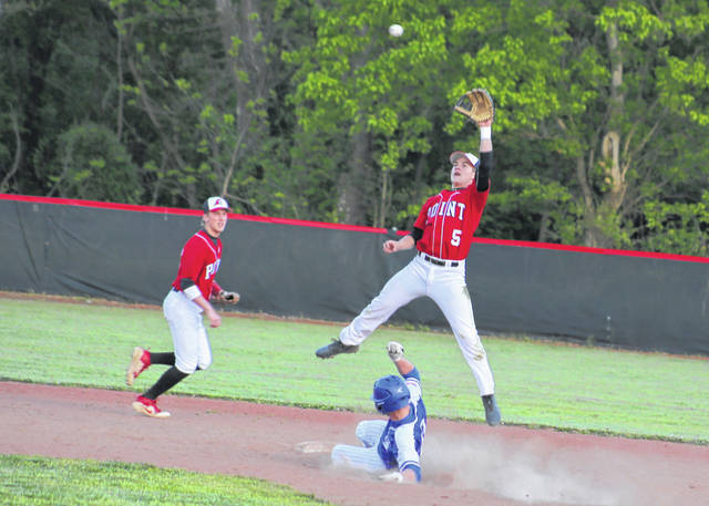 Point Pleasant sophomore Evan Roach (5) leaps for a throw at second base as Gallia Academy's Trent Johnson slides in safely during the first inning of Tuesday night's baseball contest in Point Pleasant, W.Va.