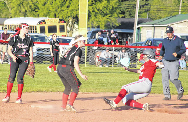 Wahama's Emma Knapp (12) slides into second base in front of Lady Knights Tayah Fetty (34) and Kaylee Byus (1), during the Lady Falcons' 7-1 victory on Wednesday in Hartford, W.Va.