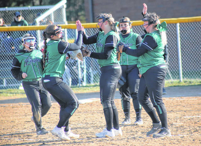 Members of the EHS infield meet in the pitcher's circle, during the Lady Eagles' April 2 bout against River Valley in Tuppers Plains, Ohio.