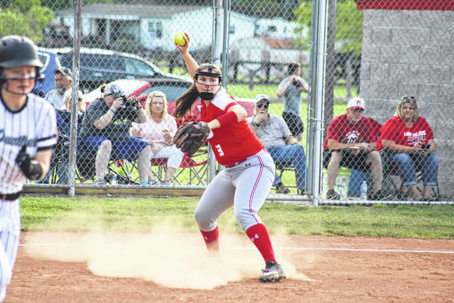 Wahama senior Victoria VanMatre (3) throws out a runner at first base, during the Lady Falcons' 2-1 victory on Thursday in Hartford, W.Va.