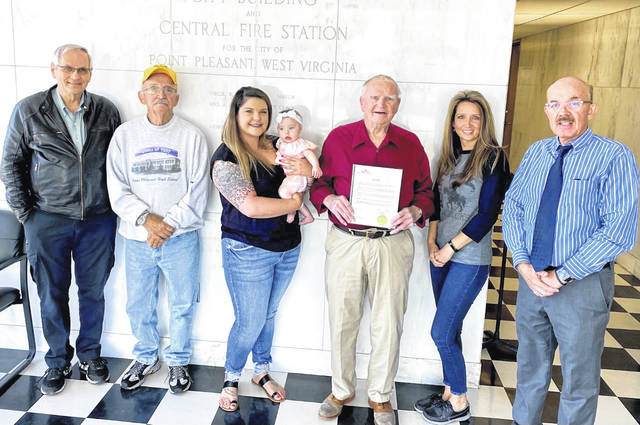 """The City of Point Pleasant recently proclaimed May 16 as """"Coach Russ Wood Day"""" in honor of his contributions by serving in the U.S. Navy, as well as to area youth and athletes at PPHS, and in recognition of his 90th birthday. Pictured from left are Lester Cochran, Jim Stearns, granddaughter Allison Porter and great granddaughter Brynlee, Coach Wood, City Clerk Amber Tatterson, Mayor Brian Billings."""