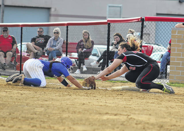 Point Pleasant first baseman Rylee Cochran, right, successfully applies a tag to Gallia Academy's Taylor Mathie during the fourth inning of Tuesday night's non-conference softball game in Point Pleasant, W.Va.