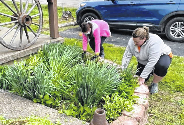 Flower beds were cleaned at the West Virginia State Farm Museum recently during the first of many Volunteer Days scheduled. The next day will be May 15.