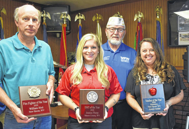 Awards were presented at the Loyalty Day dinner recently by Stewart-Johnson V.F.W. Post 9926 Commander Ray Varian, pictured in back. Winners were, from left, Firefighter of the Year William Bird, represented by Fire Chief Stephen Duncan; Jessica Thorp, EMT of the Year; and Ammie Jordan, Teacher of the Year.