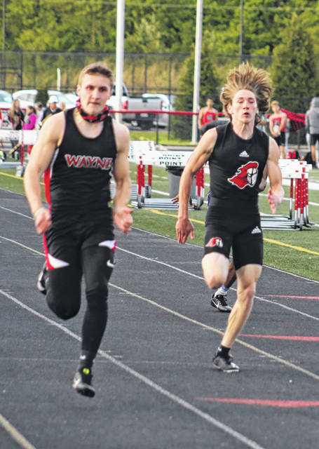 Point Pleasant junior Preston Taylor, right, hits full stride during the 100-meter dash event at the Paul Wood Invitational on Friday, May 7, in Point Pleasant, W.Va.