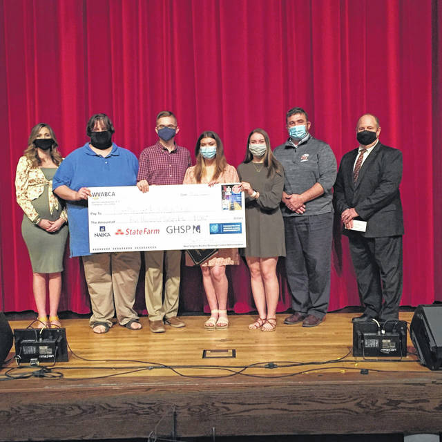 Pictured from left, Julia Davis, agent with State Farm, Andrew Layton, broadcasting class teacher and PSA faculty group leader at PPJ/SHS, Luke Blain, student, Kadann Bonecutter, student, Kenly Arbogast, student and PSA student group leader, William Cottrill, principal at PPJ/SHS, Fred Wooton, commissioner, West Virginia Alcohol Beverage Control Administration.