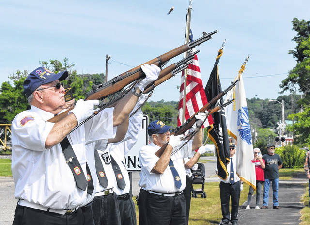 A gun salute was included in the Bend Area Memorial Day services held by members of the Stewart-Johnson V.F.W. Post 9926 of Mason and the Smith-Capehart American Legion Post 140 of New Haven.