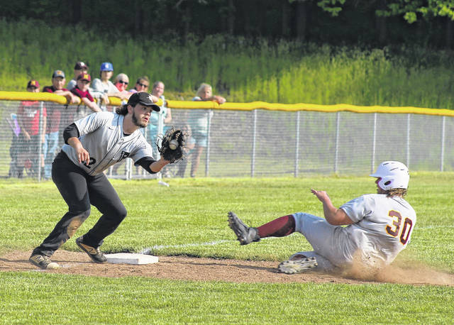 River Valley third baseman Joel Horner, left, attempts to make a tag on Meigs senior Andrew Dodson (30) during a stolen base attempt in the fourth inning of Monday night's D-3 district semifinal baseball game in Bidwell, Ohio.
