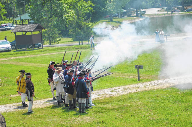 Pictured is a scene from a past Siege of Fort Randolph during the outdoor drama. In this portion, of the drama muskets are being fired by the colonials.