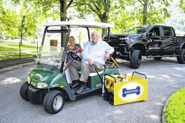Gov. Jim Justice and First Lady Cathy Justice with Babydog on Sunday.