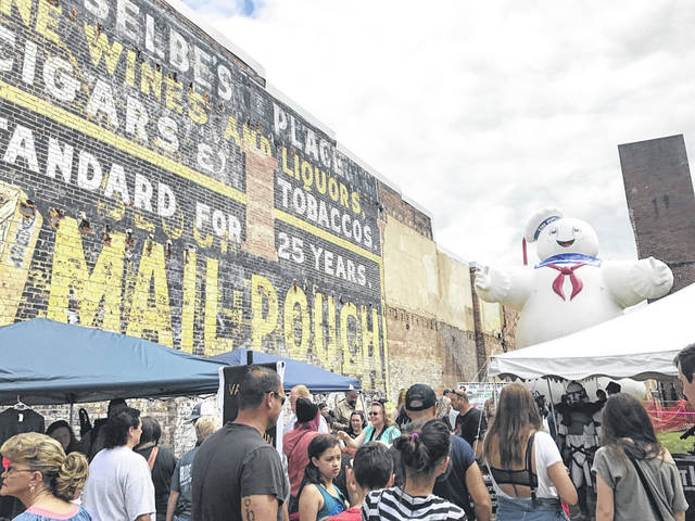 """After postponing last year due to the pandemic, the 20th Mothman Festival is on schedule for Sept. 18-19. """"We currently plan on moving forward with the Mothman Festival for 2021 assuming that we are given the OK by our state and local health departments in regards to restrictions if still in place that can be conducive in a festival setting such as ours… Thanks and hope to see you all in September,"""" read a recent post on the festival's website. Pictured is a scene from a previous festival which attracts thousands to downtown Point Pleasant."""