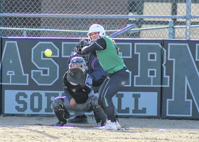 Eastern junior Megan Maxon takes a pitch, during the Lady Eagles' non-conference game against River Valley on April 2 in Tuppers Plains, Ohio.