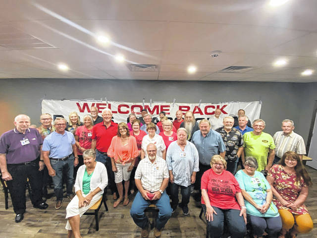 Members of the Point Pleasant High School Class of 1970 held their delayed 50th class reunion at the Point Pleasant American Legion on Saturday. Pictured is a class photo from the event.