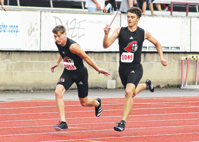 Point Pleasant juniors Preston Taylor, left, and Trey Peck make a baton exchange during the 4x200m relay final on Friday at the Class AA track and field championships held at Laidley Field in Charleston, W.Va.