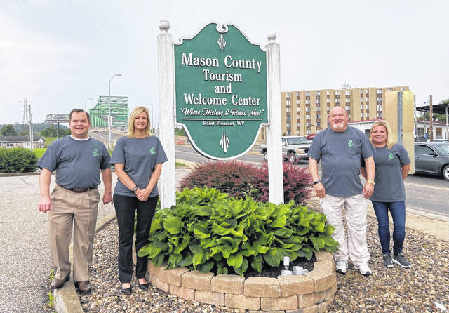 Pictured from left Jeff Noblin, CEO of Pleasant Valley Hospital; Leigh Ann Shepard, first vice president of City National Bank and chairman, Mason County Chamber of Commerce; Larry Jones, owner of Point Financial Services; and Amanda Godwin, local attorney.