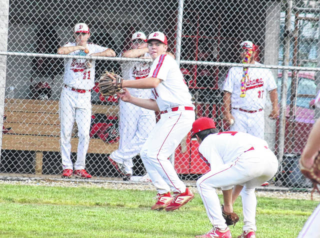Wahama third baseman Trey Ohlinger fires to first over pitcher Aaron Henry, during the White Falcons' 5-1 setback on Tuesday in Mason, W.Va.