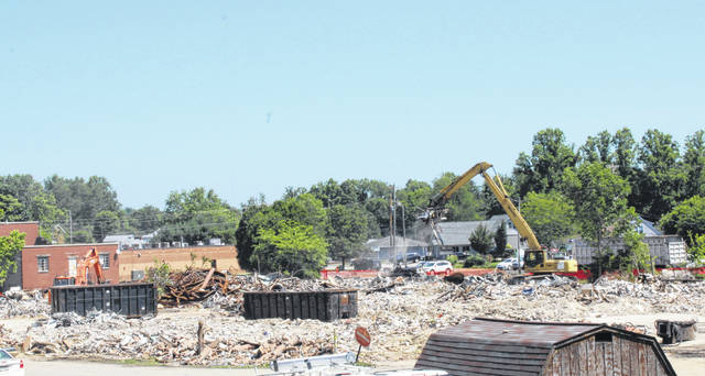 Demolition work at the former Veterans Memorial Hospital continued on Thursday, with debris being loaded into trucks.