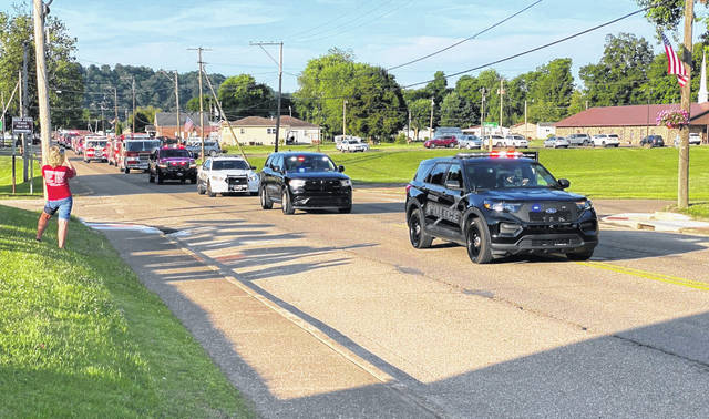 Approximately 20 police, fire, and EMS vehicles led the Wahama White Falcon Softball Team back into Mason County Wednesday evening after winning the Class A State Championship.